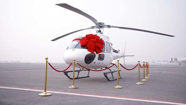"Авиакомпания ""Сомон Эйр"" провела сегодня в Международном аэропорту Душанбе презентацию своего вертолёта Airbus H125 - Sputnik Тоҷикистон"