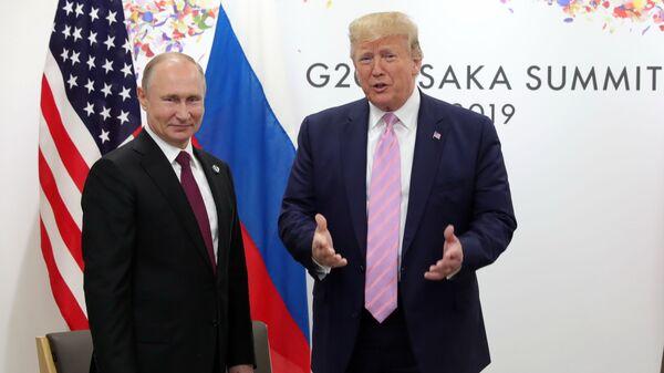 Президент РФ Владимир Путин и президент США Дональд Трамп - Sputnik Таджикистан
