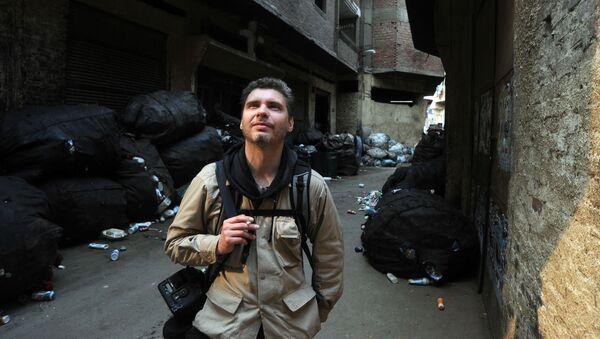 Фотокорреспондент Андрей Стенин на улице Каира - Sputnik Таджикистан