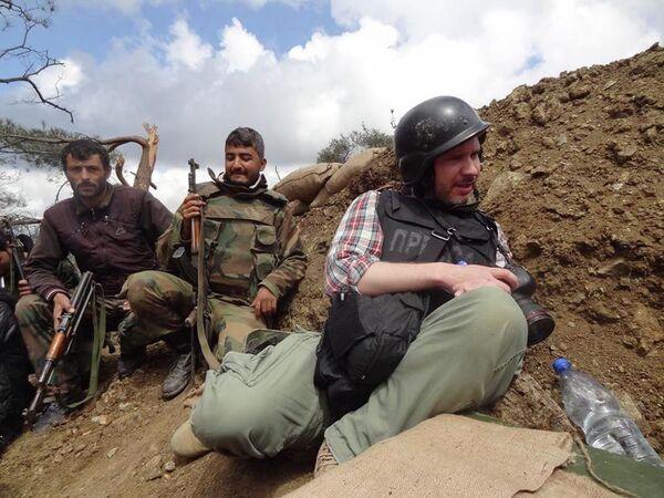Фотокорреспондент МИА Россия сегодня Андрей Стенин - Sputnik Таджикистан
