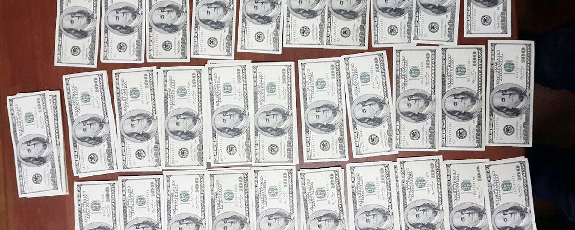 Фальшивые доллары - Sputnik Таджикистан, 1920, 19.04.2021