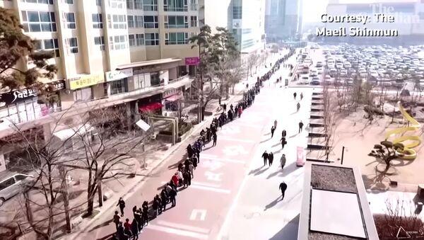 В Южной Корее сотни людей выстроились в очередь за масками - Sputnik Тоҷикистон