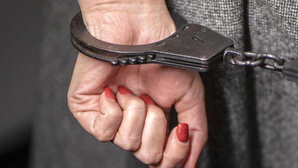 Руки в наручниках. - Sputnik Таджикистан