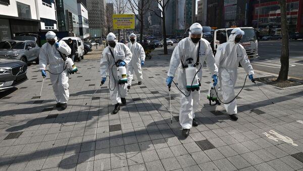 Дезинфекция от коронавируса COVID-19 на улицах южной Кореи, архивное фото - Sputnik Таджикистан