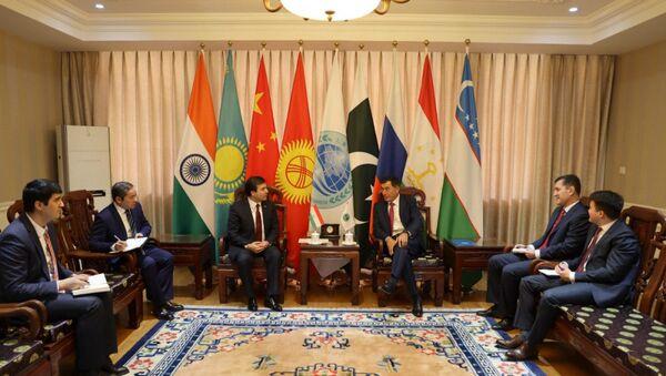 Встреча посол Таджикистана в Китае Парвиза Давлатзоды и генсека ШОС Владимира Норова - Sputnik Таджикистан