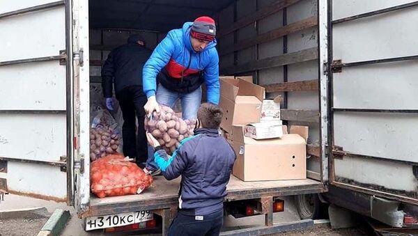 Волонтеры Международного Совета помощи мигрантам - Sputnik Таджикистан