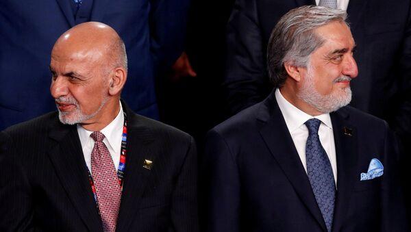 Президент Афганистана Ашраф Гани (слева) и исполнительный директор Афганистана Абдулла Абдулла - Sputnik Тоҷикистон